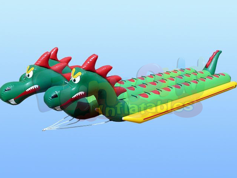 Cheap inflatable water attraction dragon water pedal boat banana boat isolated